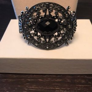 Silver cuff with black stone